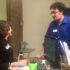 Social worker intern, Brendan Haggerty, talks with library staff.