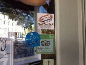 Look for the Flash Your Card decal in business windows like this one at La Luz in Old Town.